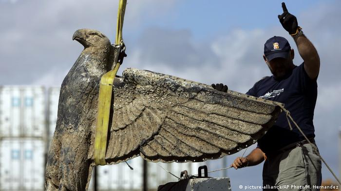 In this Feb. 10, 2006 file photo, an Uruguayan worker directs the salvage the eagle of World War II German pocket battleship Admiral Graf Spee