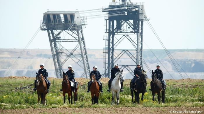 Mounted state police guard RWE's Garzweiler strip mine (Reuters/Schmuelgen)