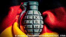 Handgranate mit dem Schriftzug extrem und Deutschlandfahne