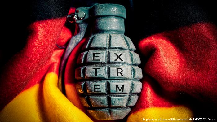 A hand grenade surrounded by the German flag