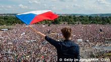 A man holds a Czech National flag during a rally demanding the resignation of Czech Prime Minister Andrej Babis on June 23, 2019 in Prague. - Huge crowds flooded central Prague demanding Prime Minister Andrej Babis to step down over allegations of graft in a protest that organisers and local media claim drew around 250,000 people, which would make it the largest since the fall of communism in 1989. (Photo by Michal Cizek / AFP) (Photo credit should read MICHAL CIZEK/AFP/Getty Images)