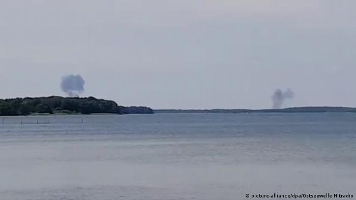 Two plumes of smoke billow up, 10km from each other