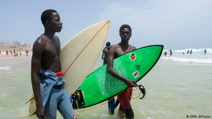 Local surfers on the beach of Yoff, in Dakar, Senegal.