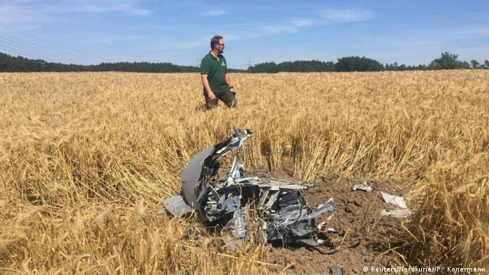 A forest official stands next to debris after two Eurofighter warplanes crashed