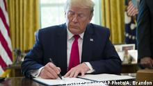 24.06.2019 President Donald Trump signs an executive order to increase sanctions on Iran, in the Oval Office of the White House, Monday, June 24, 2019, in Washington. (AP Photo/Alex Brandon)  