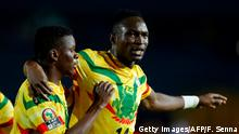 Mali's forward Adama Traore (R) celebrates his second goal during the 2019 Africa Cup of Nations (CAN) football match between Mali and Mauritania at the Suez Stadium in Suez on June 24, 2019. (Photo by FADEL SENNA / AFP) (Photo credit should read FADEL SENNA/AFP/Getty Images)