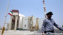 FILE- epa05070463 A file photograph showing an Iranian security officer walking in front of the nuclear power plant in Bushehr , southern Iran on 21 August 2010. EPA/ABEDIN TAHERKENAREH (zu dpa Angereichertes Uran im Iran nach Russland verschifft vom 29.12.2015) +++(c) dpa - Bildfunk+++ |