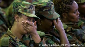 Troops cry at a ceremony for the assassinated army chief