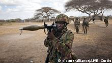 A Kenyan army soldier carries a rocket-propelled grenade launcher as he patrols in Tabda, inside Somalia in this 2012 file photo
