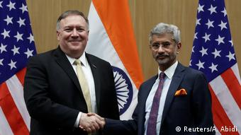 US Secretary of State Mike Pompeo and India's Foreign Minister Subrahmanyam Jaishankar shake hands at a joint news conference after a meeting in New Delhi