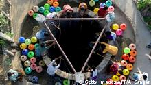 TOPSHOT - In this photo taken on June 20, 2019, Indian residents get water from a community well in Chennai after reservoirs for the city ran dry. - The drought is the worst in living memory for the bustling capital of Tamil Nadu state, India's sixth largest city, that is getting less than two thirds of the 830 million litres of water it normally uses each day. (Photo by ARUN SANKAR / AFP) (Photo credit should read ARUN SANKAR/AFP/Getty Images)