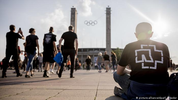 Visitors to a Rammstein concert tour: black t-shirt with the Rammstein logo
