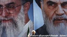 Iran Hassan Rohani, Präsident vor Porträts von Ayatollah Ali Khamenei