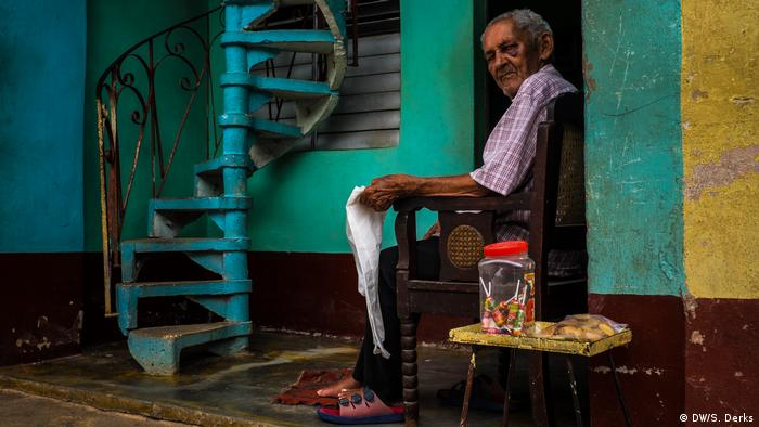 A man sitting in front of his house in Cuba