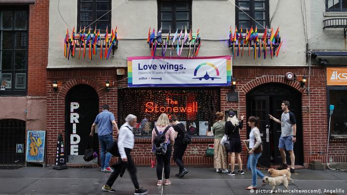 Poeple stop to take pictures of the Stonewall Inn in New York City