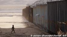 A large wall goes into the Pacific Ocean at the beaches of San Diego and Tijuana.