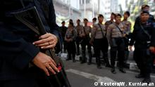 Riot-policeman stands guard with tear gas gun at Indonesia's Constitutional Court, ahead of the verdict of challenge to overturn the official result of the April's presidential election, in Jakarta, Indonesia, June 27, 2019. REUTERS/Willy Kurniawan