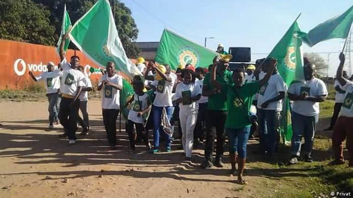 Members of the Mozambican Green Party marching and carrying flags