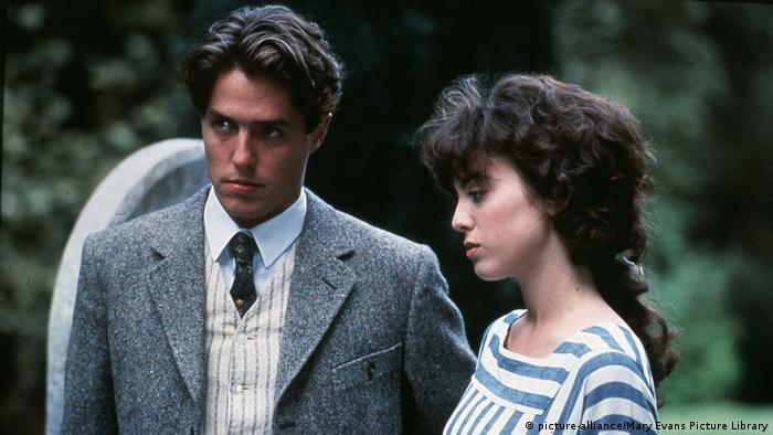 Film still MAURICE a young man in a tweed jacket, vest and tie, and a young woman (picture-alliance/Mary Evans Picture Library)