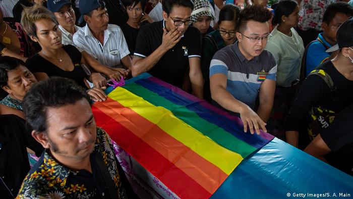 Mourners grieve the loss of Kyaw Zin Win at his funeral