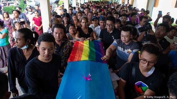 Funeral for Kyaw Zin Win. His casket is wrapped in a rainbow flag.