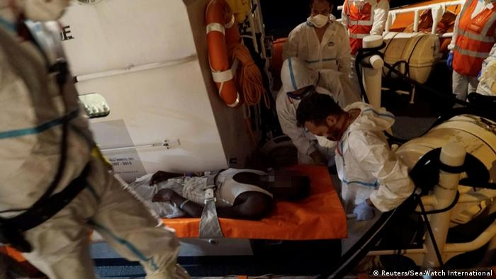 A sick man is taken off the Sea-Watch 3 on a stretcher