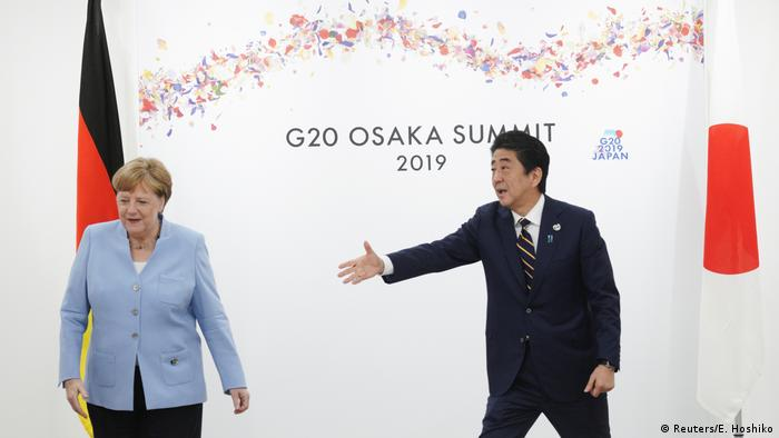 German Chancellor Angela Merkel and Japanese Prime Minister Shinzo Abe at the G20 summit in Osaka, Japan