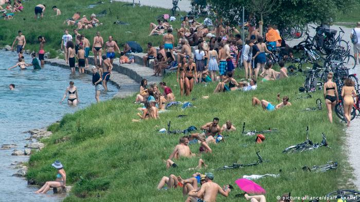 People on the Isar River in Munich, Germany