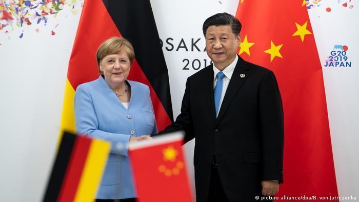 آنگلا مرکل، صدراعظم آلمان، و شی جینپینگ، رئیس جمهور چین، در حاشیه اجلاس سران کشورهای جی۲۰ در اوزاکا