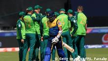 Sri Lanka's Kusal Mendis (C) walks off after losing his wicket for 23 during the 2019 Cricket World Cup group stage match between Sri Lanka and South Africa at the Riverside Ground, in Chester-le-Street, northeast England, on June 28, 2019. (Photo by Lindsey PARNABY / AFP) / RESTRICTED TO EDITORIAL USE (Photo credit should read LINDSEY PARNABY/AFP/Getty Images)