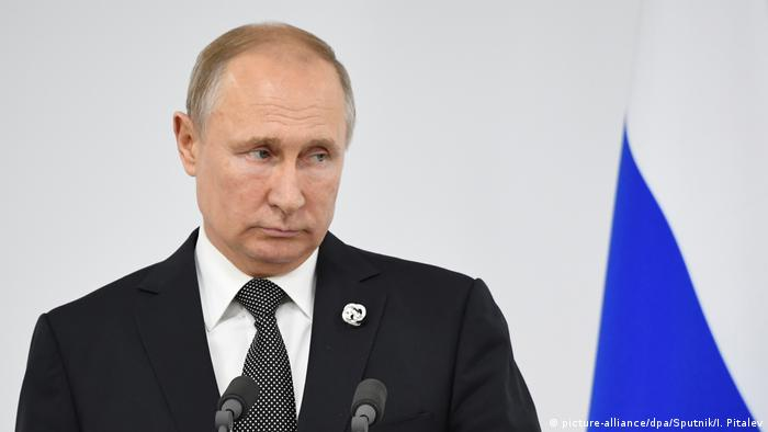 Russian President Vladimir Putin attends a news conference following the G20 summit in Osaka, Japan