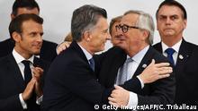 Japan | G20 Gipfel - Argentiniens Präsident Macri mit EU-Kommissions Präsident Jean-Claude Juncker