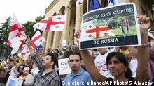 Opposition demonstrators attend a protest rally in central Tbilisi, Georgia, Saturday, June 29, 2019. Anti-government protests have continued for over a week in the Georgian capital amid persistent anger about police violence and the government's policies toward Russia. (AP Photo/Shakh Aivazov) |