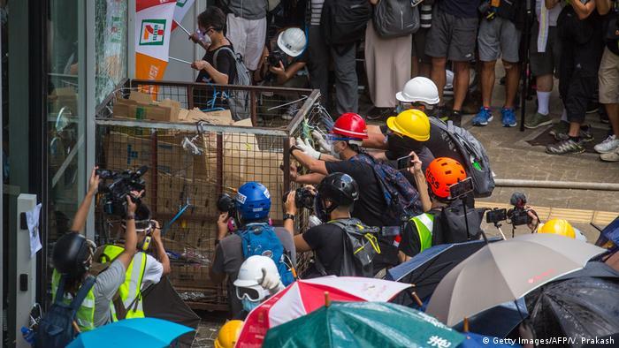Protesters ram a metal cart into Hong Kong's Legislative Council