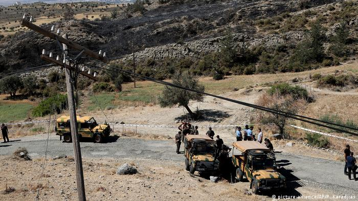 Turkish soldiers and police guard the area after an explosion pre-dawn, outside of village of Tashkent in Turkish Cypriot breakaway north part of the divided Cyprus, Monday, July 1, 2019.
