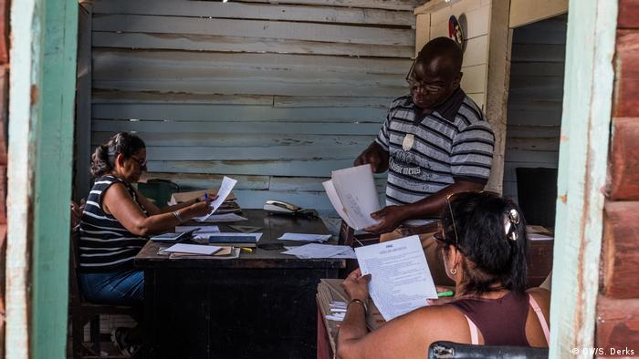 Farmers in Cuba going through documents
