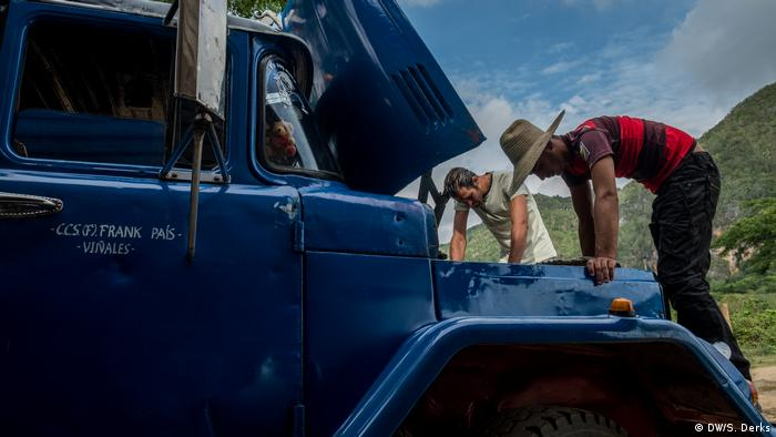 Farmers in Cuba checking their truck