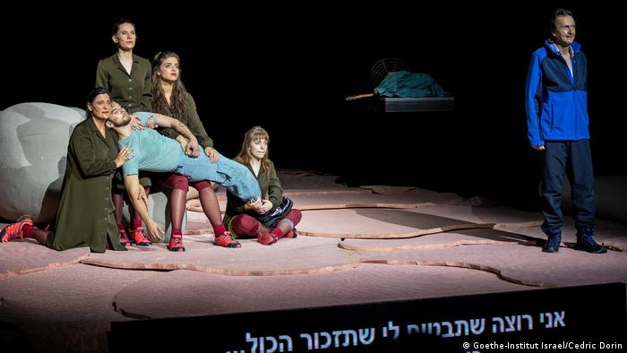 Four actors onstage hold a man draped across them in a performance of David Grossman's novel To the End of the Land by the Schauspiel Frankfurt in Tel Aviv (Goethe-Institut Israel/Cedric Dorin)