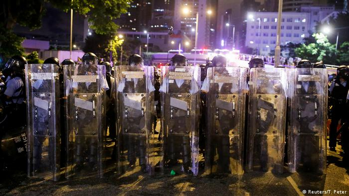 Police clear the streets after protesters stormed the Legislative Council building in Hong Kong on July 1