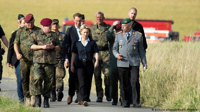 Defense Minister Ursula von der Leyen (center) extended her condolences to the family of the pilot who was killed in the accident