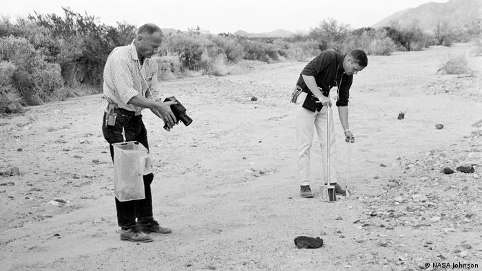 Apollo 11 astronauts Buzz Aldrin and Neil Armstrong training in geology. Armstrong is using a sample scoop, while Aldrin films him with a Hasselblad camera (NASA Johnson)