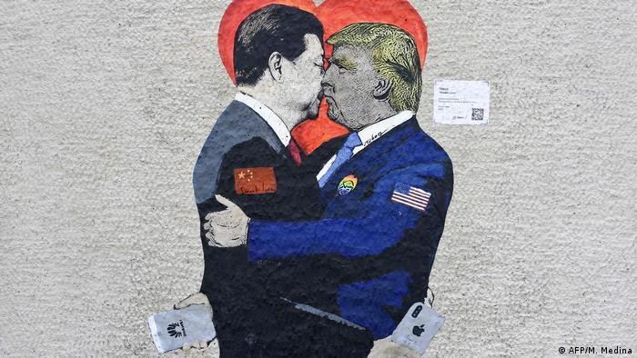 A mural of a kissing Donald Trump and Xi Jinping