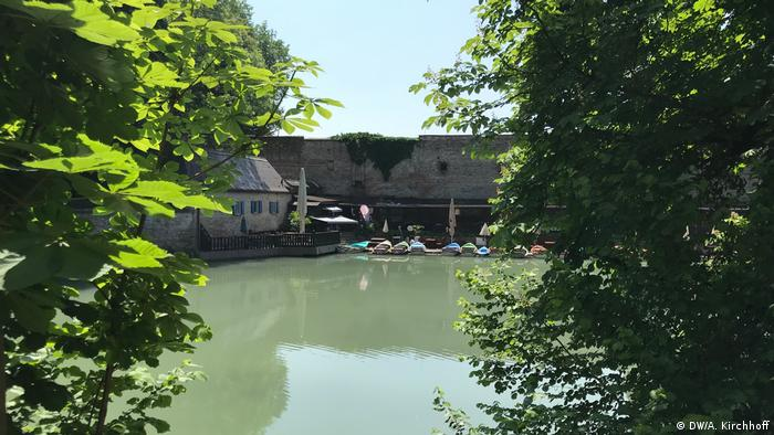 Lake with boats at the former city wall, Augsburg, Germany
