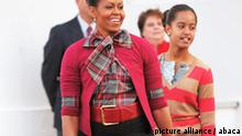 First Lady Michelle Obama and daughter Malia arrive to welcome the official White House Christmas Tree, at the North Portico of the White House on November 27, 2009 in Washington, DC. The 18 and a half foot Douglas fir will stand in the Blue Room throughout the holidays. Photo by Olivier Douliery /ABACAUSA.COM (Pictured: Malia Obama, Michelle Obama)
