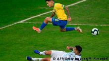 Brazil's Philippe Coutinho jumps over Argentina's Leandro Paredes during their Copa America football tournament semi-final match at the Mineirao Stadium in Belo Horizonte, Brazil, on July 2, 2019. (Photo by Mauro PIMENTEL / AFP) (Photo credit should read MAURO PIMENTEL/AFP/Getty Images)