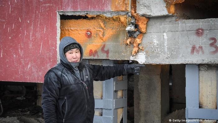 A building subsides in Yakutsk, Siberia, as permafrost melts beneath its foundations
