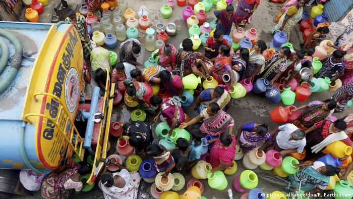 Women queue for water from a truck as Chennai suffers drought