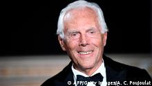 Italian fashion designer Giorgio Armani acknowledges the audience at the end of his 2019 Spring-Summer Haute Couture collection fashion show in Paris, on January 22, 2019. (Photo by Anne-Christine POUJOULAT / AFP) (Photo credit should read ANNE-CHRISTINE POUJOULAT/AFP/Getty Images)