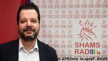 Tunisian lawyer Mounir Baatour (L), president of the association Shams which supports the depenalization of homosexuality in Tunisia and president of Shams Radio, the first LGBT radio in the Arab region, poses in the studio as he arrives for the opening of the radio station on December 18, 2017 in Tunis. / AFP PHOTO / FETHI BELAID (Photo credit should read FETHI BELAID/AFP/Getty Images)