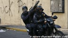 A detained anti-government protester is driven away on a motorcycle driven by a National Police during clashes between protesters and security forces, in Caracas, Venezuela, Wednesday, May 1, 2019. Opposition leader Juan Guaidó called for Venezuelans to fill streets around the country Wednesday to demand President Nicolás Maduro's ouster. Maduro is also calling for his supporters to rally. (AP Photo/Fernando Llano) |